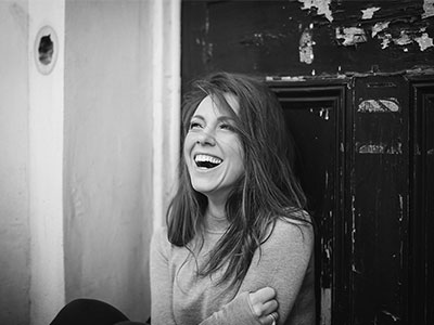 black and white photo of mary bevan laughing