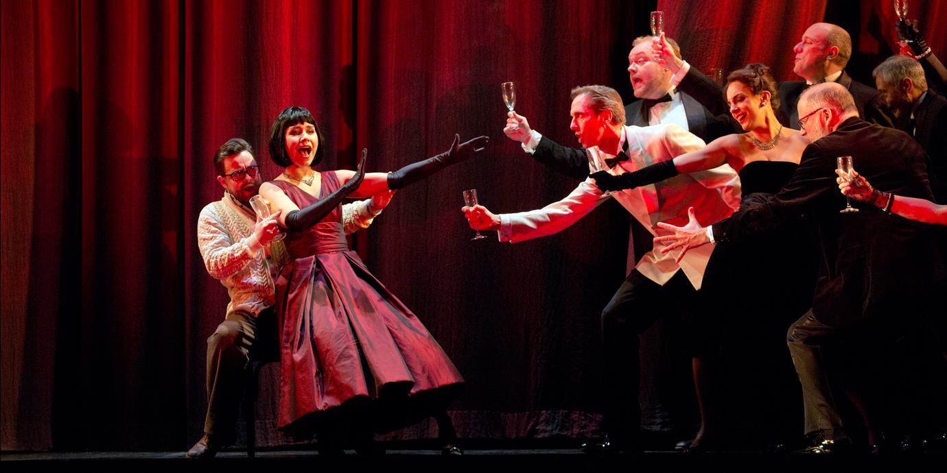 ENO's La traviata - Elizabeth Zharoff as Violetta, Ben Johnson as Alfredo and ENO Chorus. Photo by Donald Cooper.