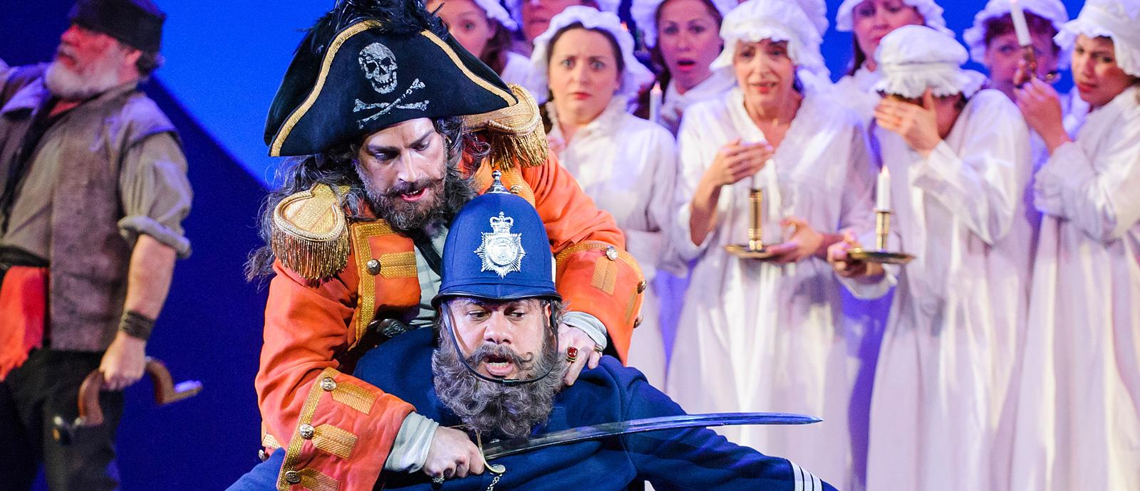 ENO's The Pirates of Penzance - Joshua Bloom as the Pirate King and Jonathan Lemalu as Sergeant of Police. Photo by Tristram Kenton