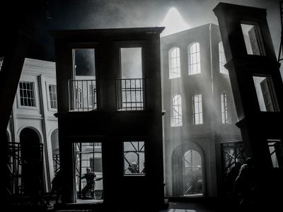 staging of five sides of a building on stage