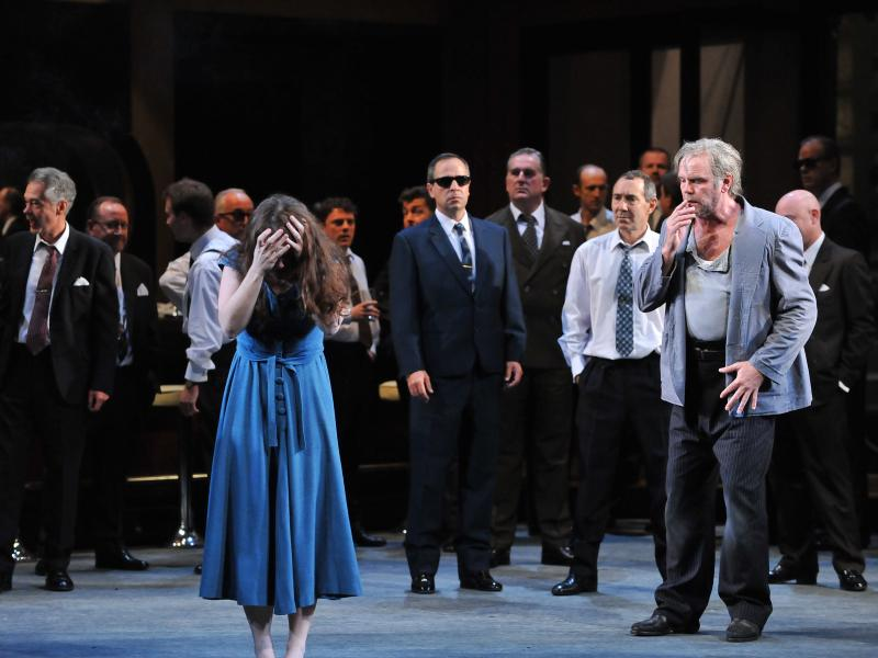 cast of rigoletto performing on stage with katherine whyte and anthony michaels-moore