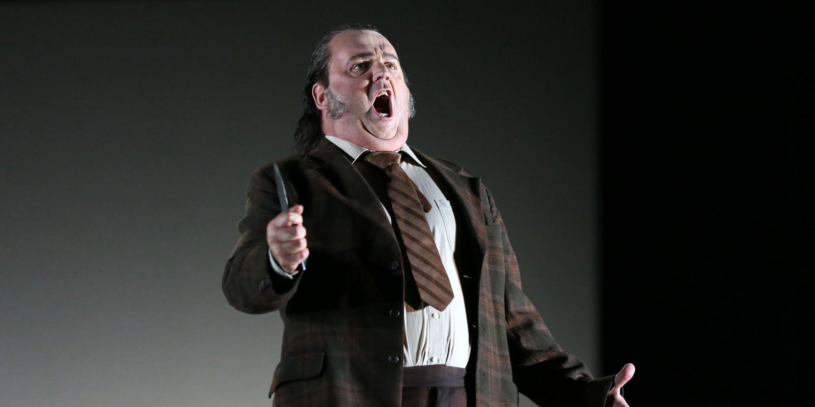 man singing and holding a knife in ENO's Jenufa