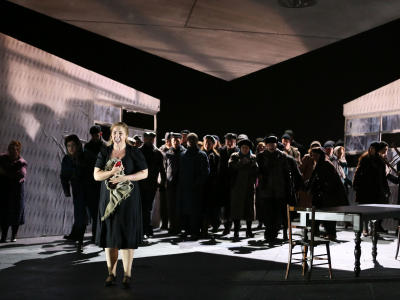 jenufa laura wilde performing on stage with eno chorus