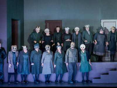 don giovanni chorus in scary masks on stage