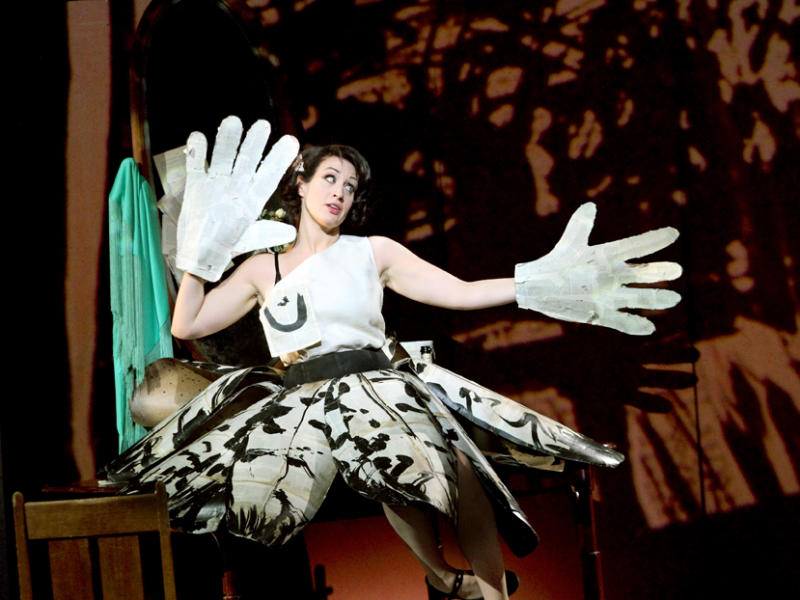 woman in black and white costume on stage of Lulu wearing giant white gloves