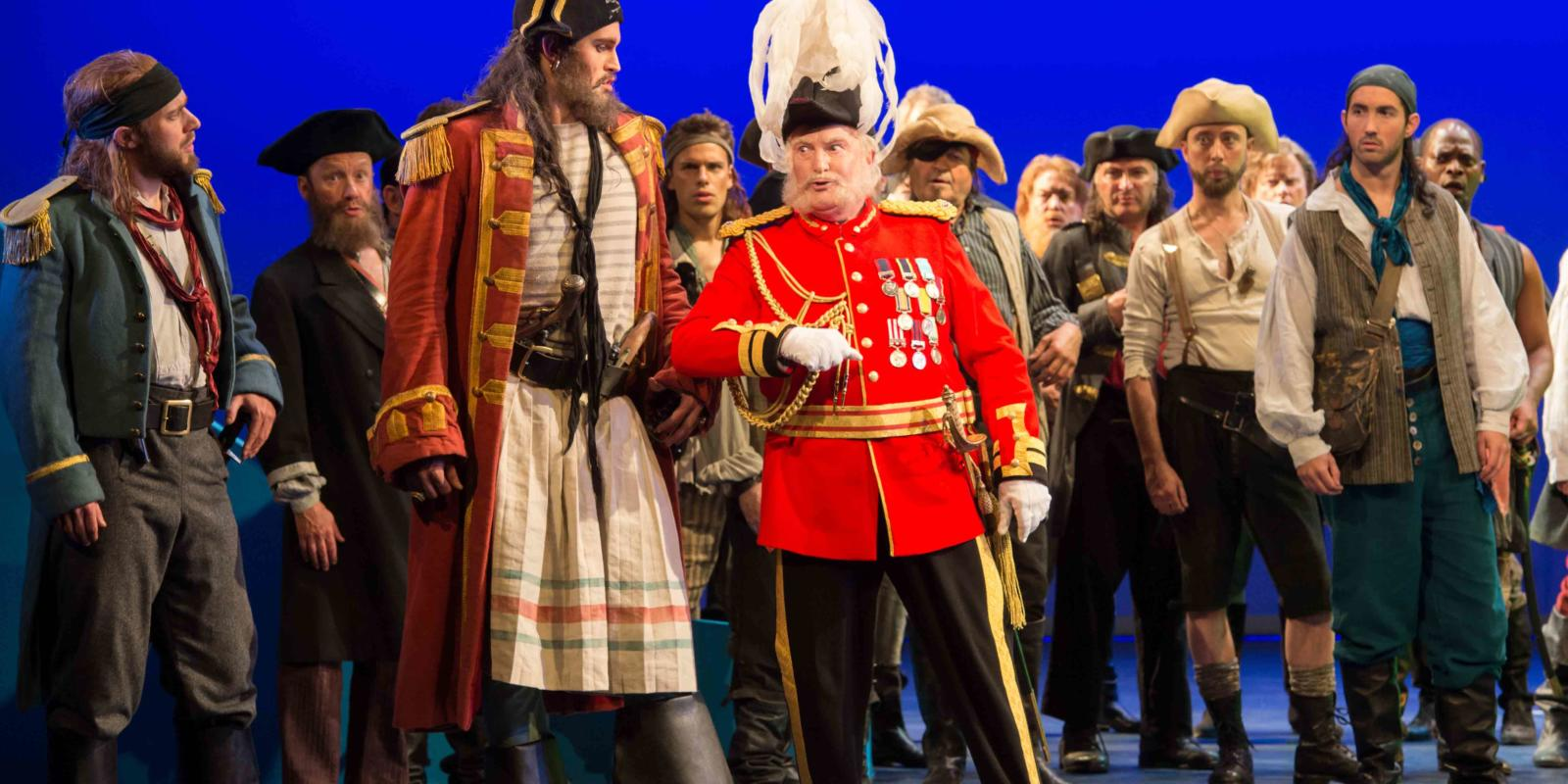 ENO's The Pirates of Penzance - Ashley Riches as The Pirate King and Andrew Shore as the Major-General. Photo by Tom Bowles