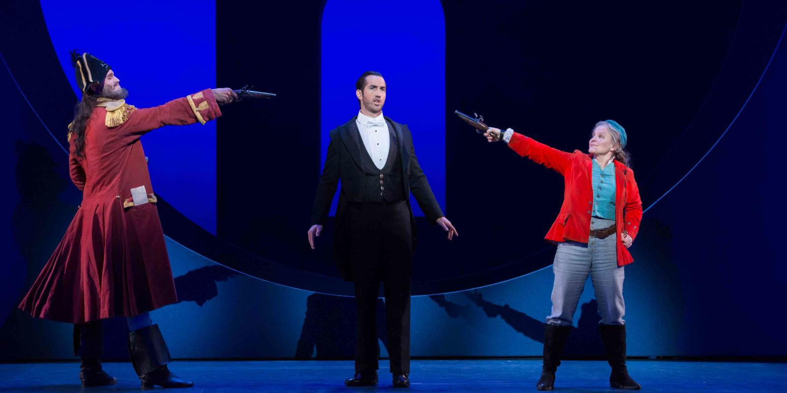 ENO's The Pirates of Penzance - Ashley Riches as The Pirate King, David Webb as Frederic and Lucy Schaufer as Ruth. Photo by Tom Bowles