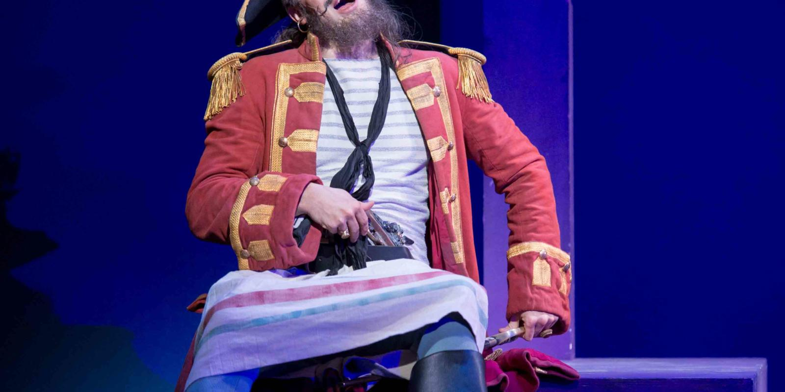 ENO's The Pirates of Penzance - Ashley Riches as The Pirate King. Photo by Tom Bowles