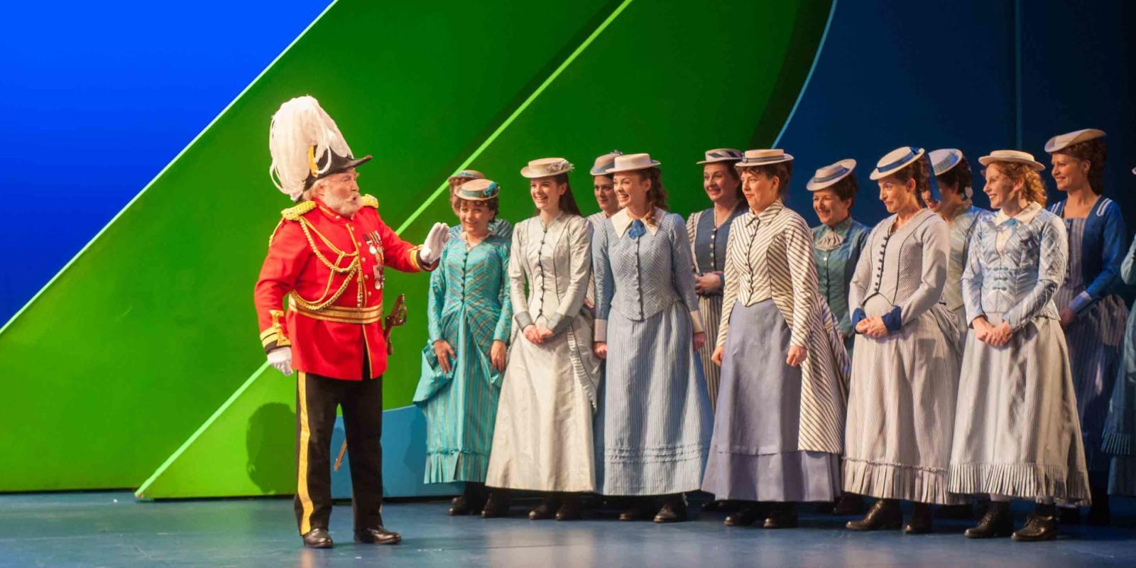 ENO's The Pirates of Penzance - David Shore as the Major-General, Soraya Mafi as Mabel, Katie Coventry as Edith, Angharad Lyddon as Kate and ENO Chorus. Photo by Tom Bowles