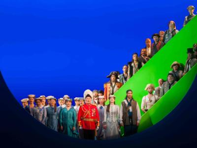 round image of cast from pirates of penzance on stage