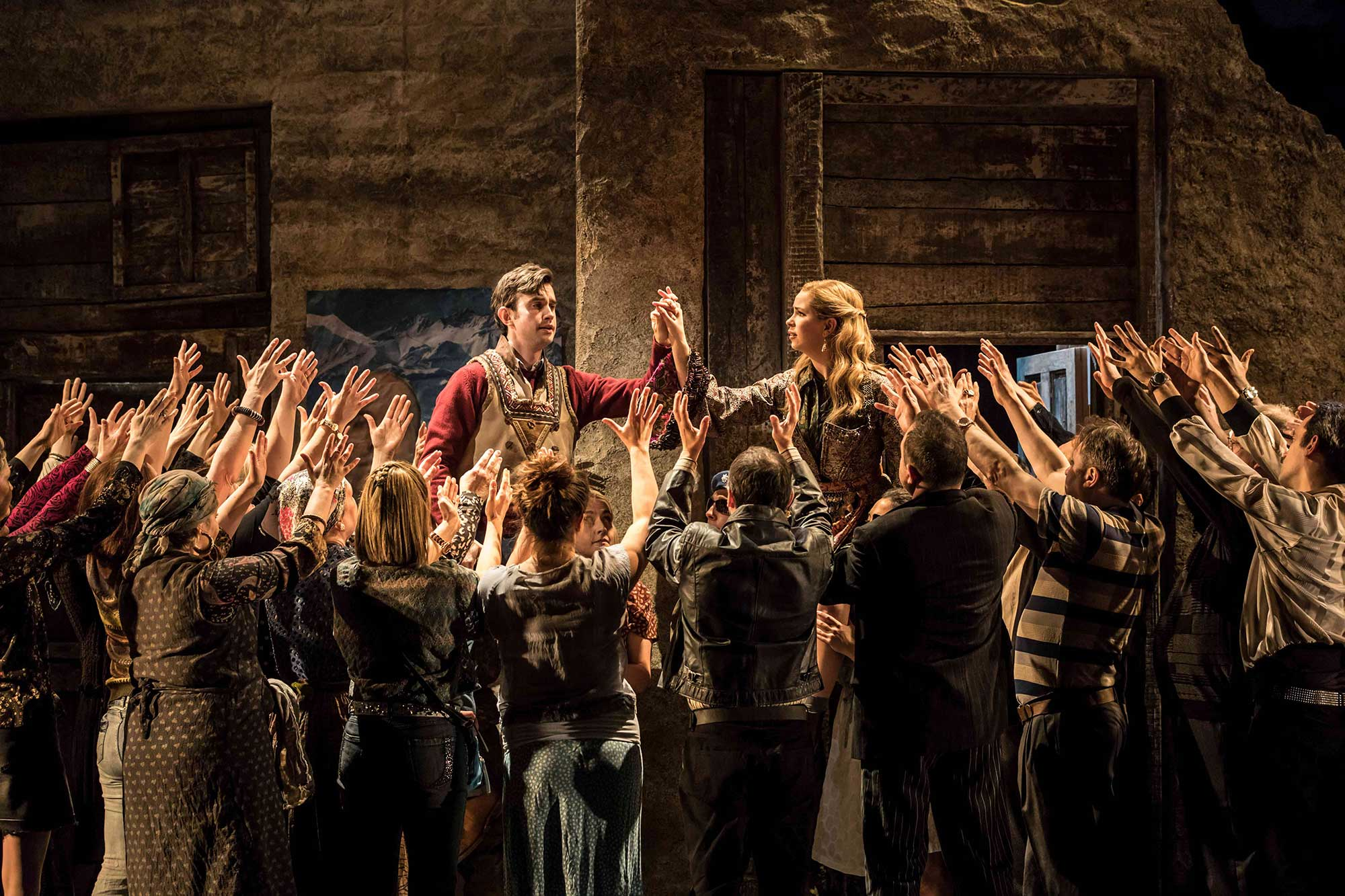 main characters in the winters tale are lifted up by the chorus on stage