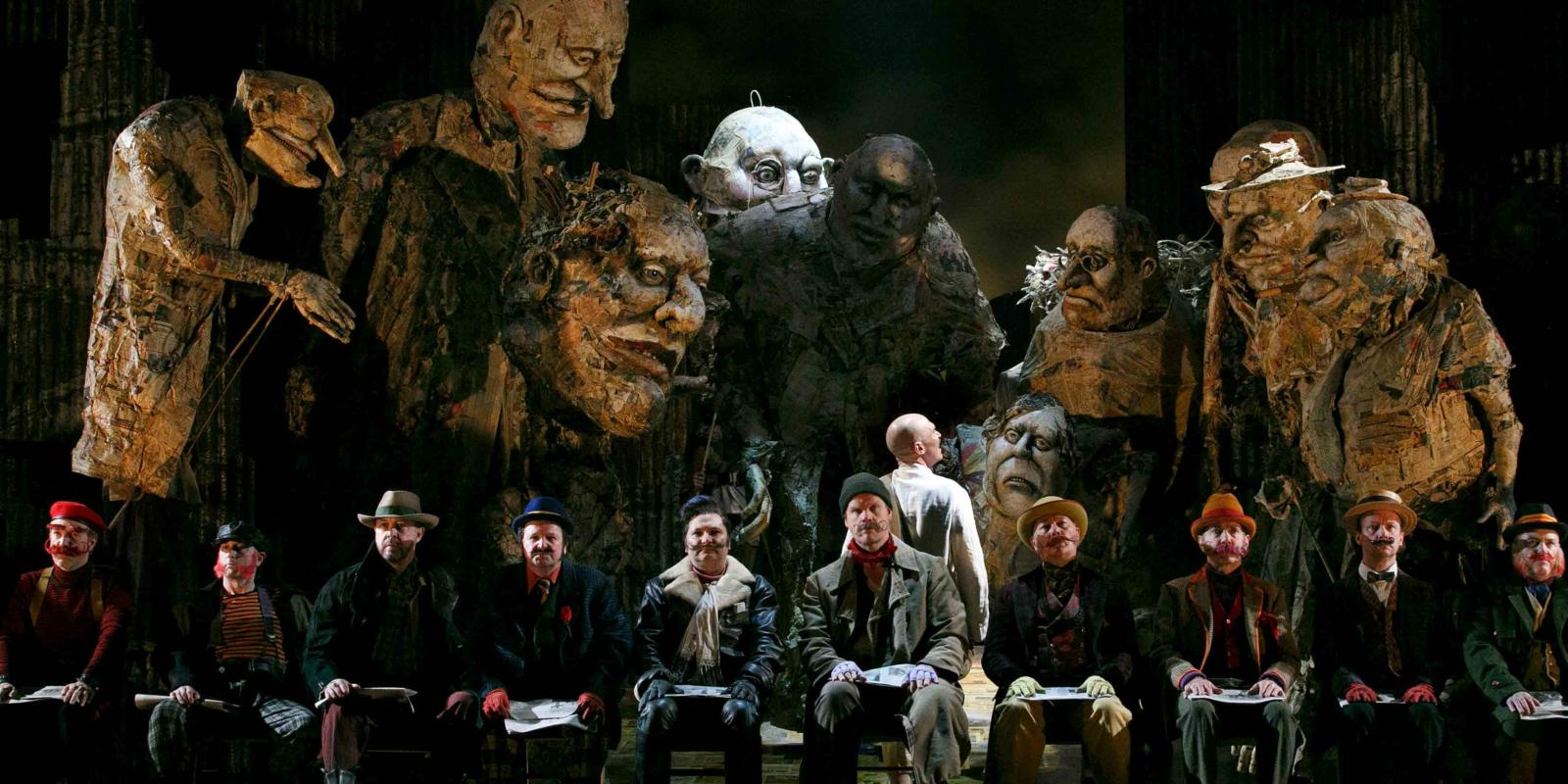 An image of Alan Oke and members of the ENO Chorus in Phelim McDermott's 2013 production of Satyagraha