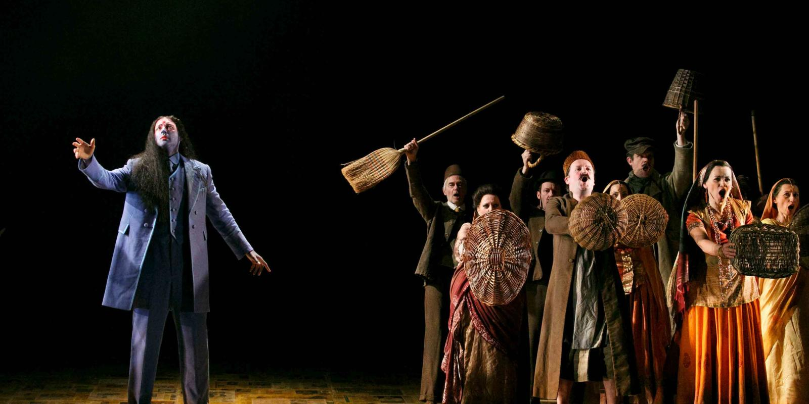 An image of Nicholas Masters and members of the ENO Chorus in Phelim McDermott's 2013 production of Satyagraha