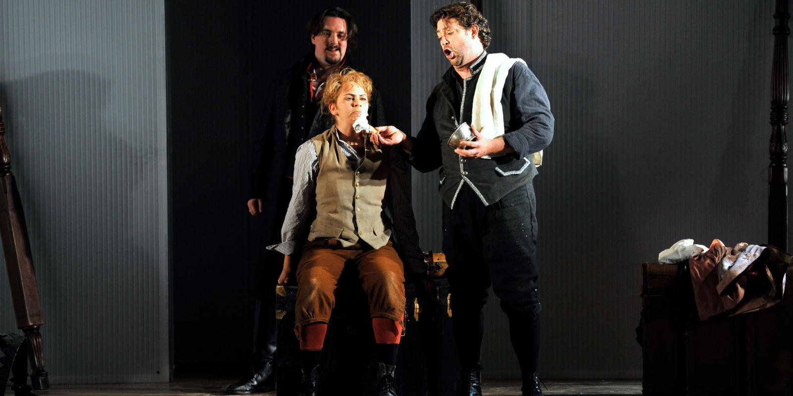 An image of Benedict Nelson, Samantha Price and David Stout in Fiona Shaw's 2014 production of The Marriage of Figaro