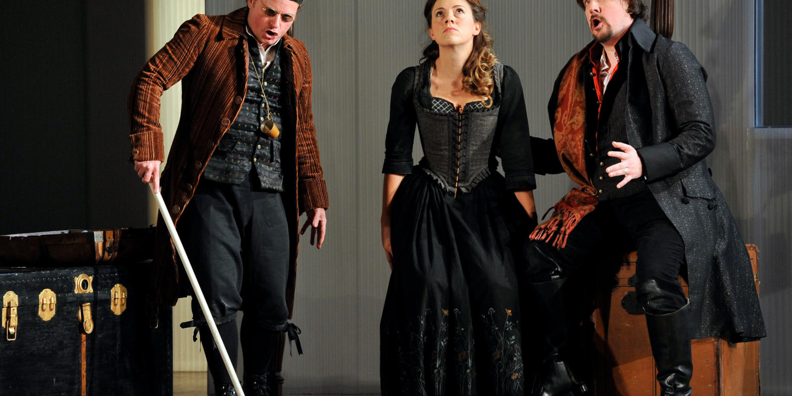 An image of Colin Judson, Mary Bevan and Benedict Nelson in Fiona Shaw's 2014 production of The Marriage of Figaro