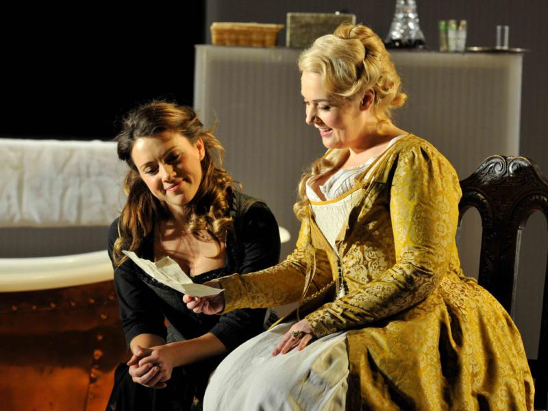 An image of Mary Bevan and Sarah Jane Brandon in Fiona Shaw's 2014 production of The Marriage of Figaro
