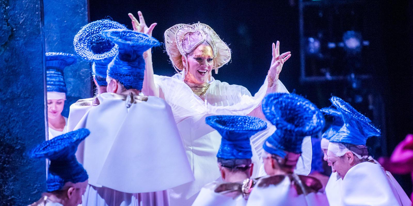 Michelle DeYoung, who sings as Aida's love-rival Ammeris, with the ENO chorus ladies (c) Tristram Kenton
