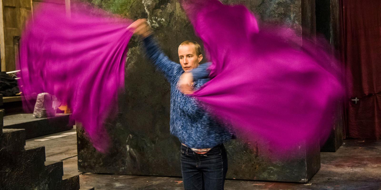 Movement Director Lina Johansson tests out some silk props (c) Tristram Kenton