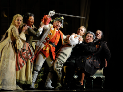 characters from Barber of Seville fighting on stage looking scared
