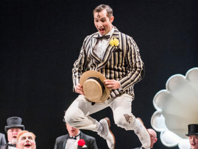 david webb performing on stage in a striped suit and hat in Marvellous Miller
