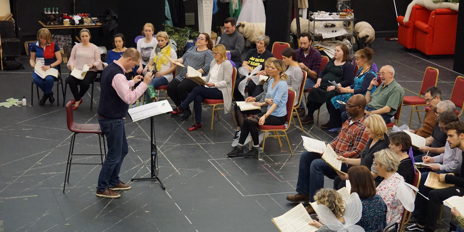 ENO Iolanthe: conductor Tim Henty rehearsing with members of the ENO chorus