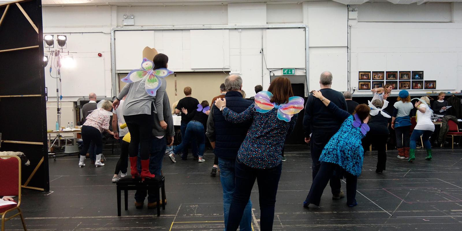 ENO Iolanthe: members of the ENO chorus dancing in pairs