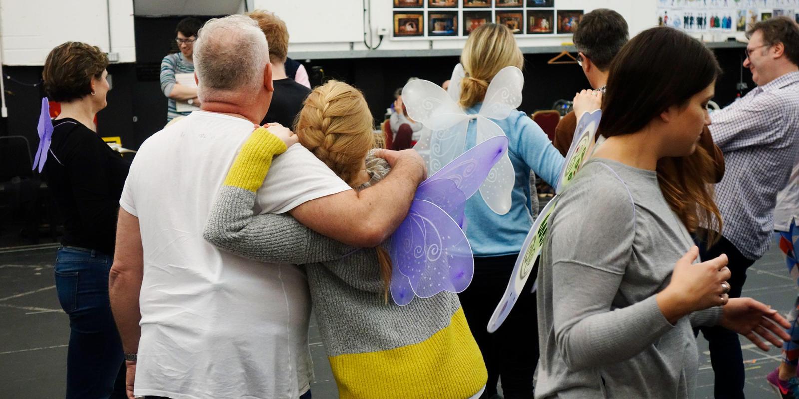 ENO Iolanthe: chorus members hugging