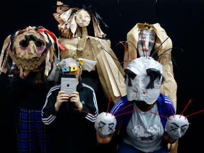 Members of the ENO Youth Company creating wearing the masks they created