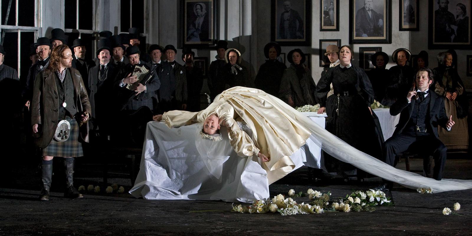 ENO Lucia di Lammermoor Anna Christy Dwayne Jones and members of ENO Chorus (c) Robert Workman