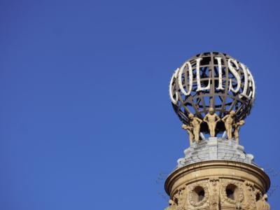 london coliseum globe against a blue sky