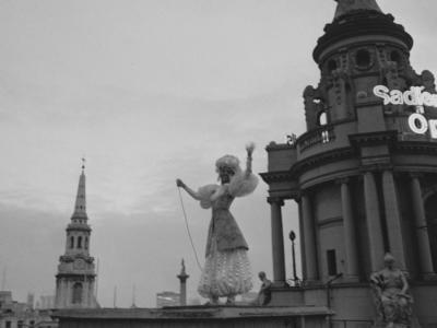 Ballet dancer Susan Hunt lights up London Coliseum's globe after repairs, 1968 (c) Maher/Stringer