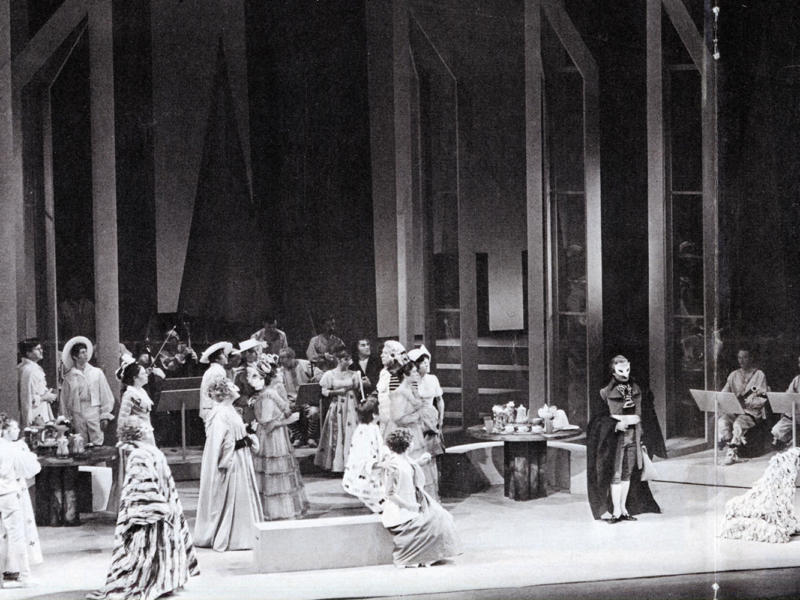 A black and white photograph of ensemble on the stage at the opening night of Don Giovanni in 1968