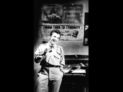black and white photo of arthur davies laughing