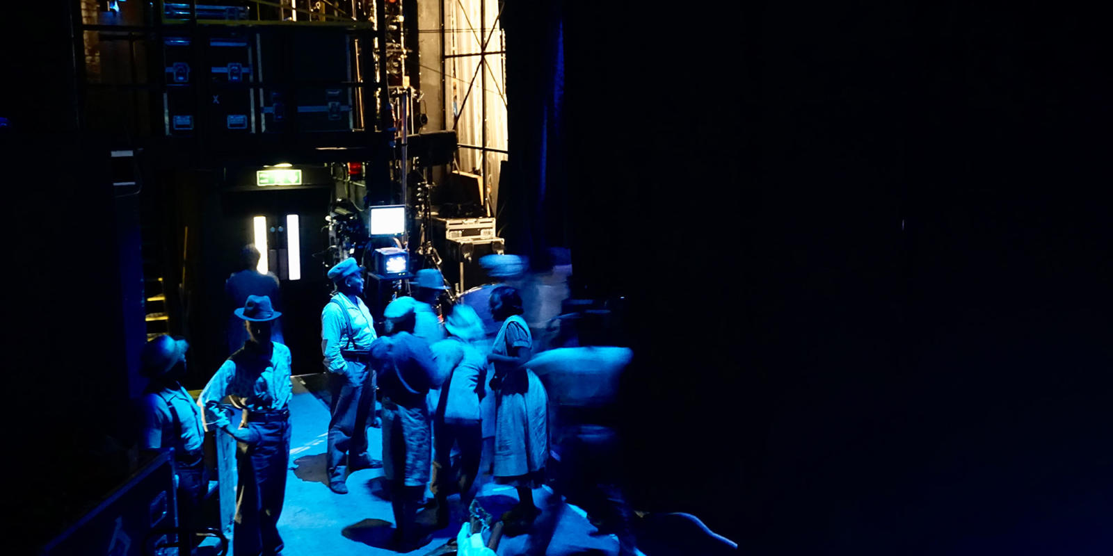 ENO Porgy and Bess: Members of the ensemble wait in the wings