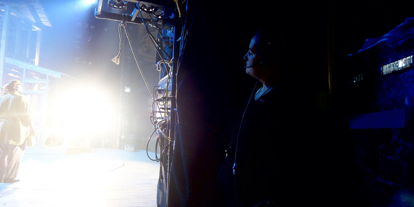 Stage manager Rosie Davis looks on from the wings