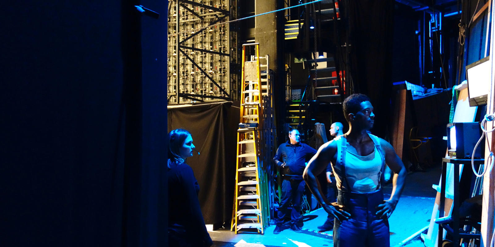 Assistant Stage Manager Becca Vince (left) and Nmon Ford (right) watch the performance from backstage