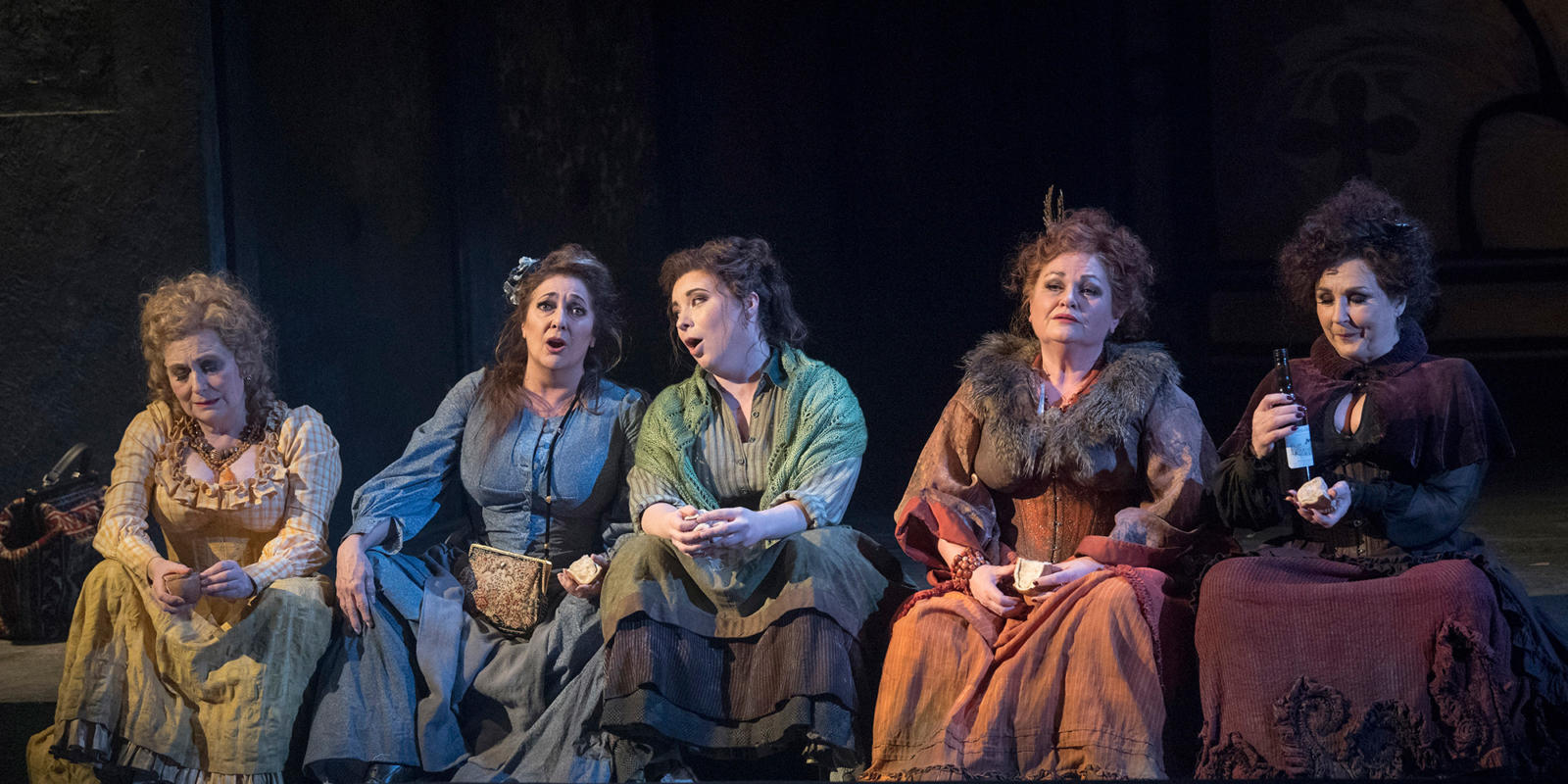 The five women of Whitechapel each holding a piece of pork pie and one holding a bottle of wine