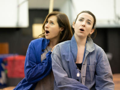 Female opera singers rehearsing