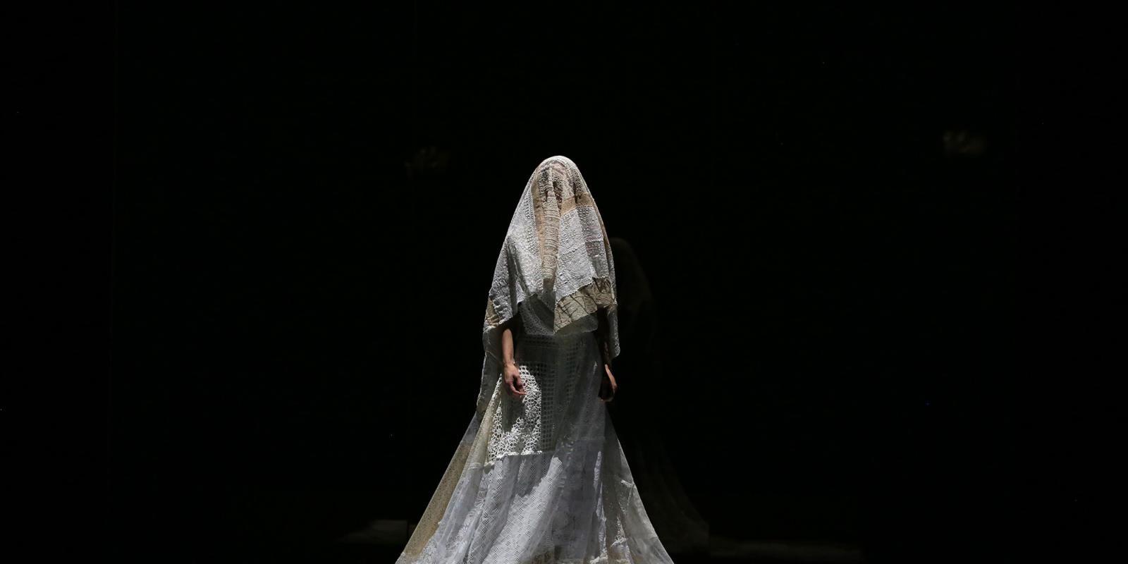 Sarah Tynan on stage in a wedding dress