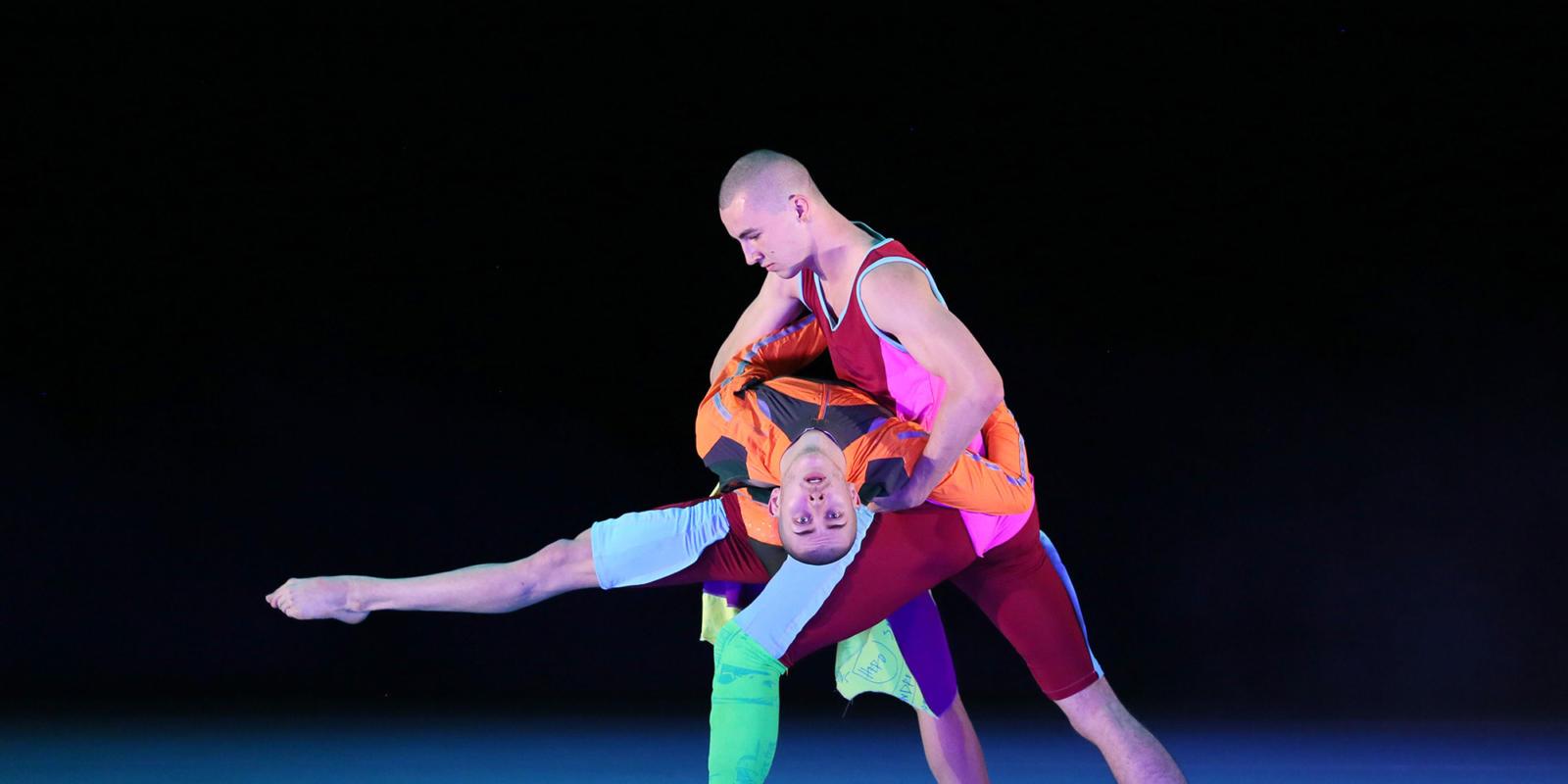 Two male dancers from studio Wayne McGregor
