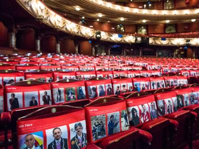seat covers of school children on seats at london coliseum