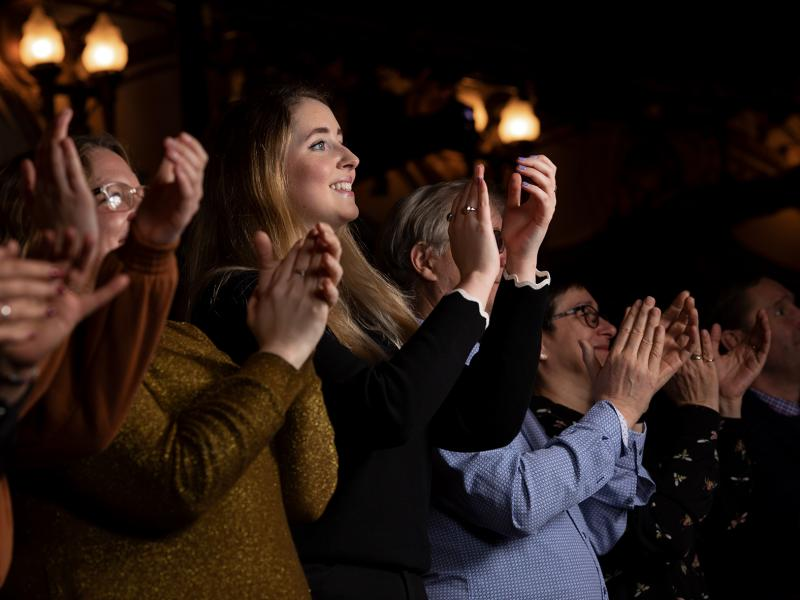 Audience clapping inside the auditorium of the London Coliseum