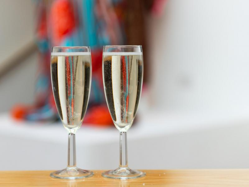 two filled champagne flutes on a table